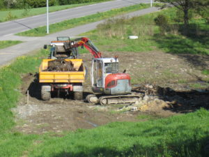 Gravemaskin på Fredheim